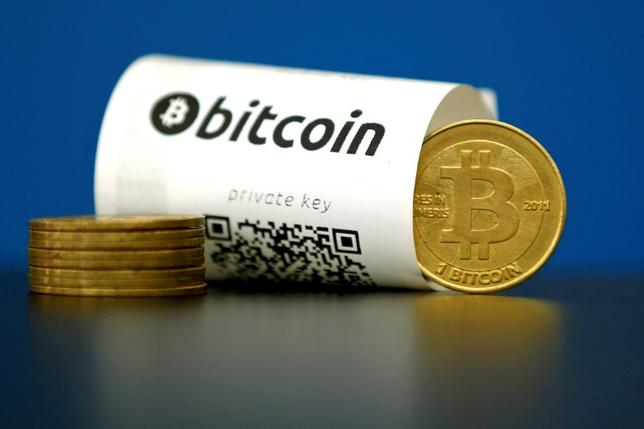 FILE PHOTO: A Bitcoin (virtual currency) paper wallet with QR codes and a coin are seen in an illustration picture taken in Paris, France May 27, 2015.  REUTERS/Benoit Tessier/File Photo