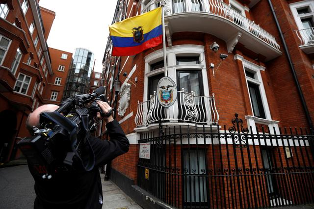 A cameraman films  outside the Ecuadorian embassy in London where WikiLeaks founder Julian Assange is taking refuge, London, Britain, May 19, 2017. REUTERS/Peter Nicholls