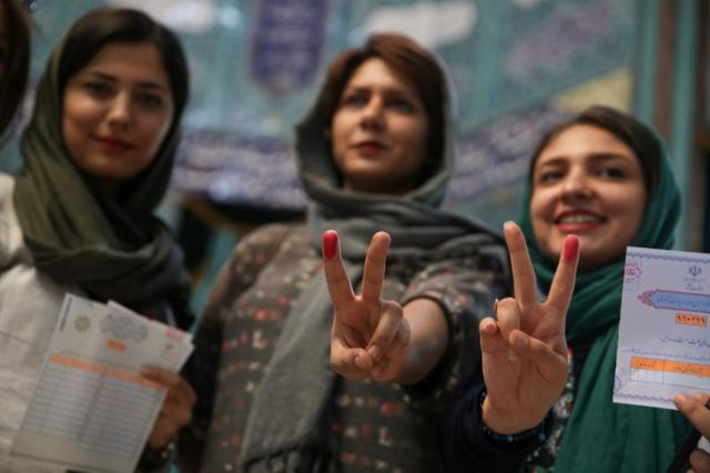 Iranian women show their ink-stained fingers after casting their votes during the presidential election in Tehran, Iran, May 19, 2017. TIMA via REUTERS
