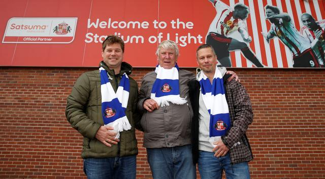Andreas (L), 43, Harold (C), 70, and Michael, 45, from Germany, pose for a photograph at a Premier League soccer match between Sunderland and Swansea, in Sunderland, Britain May 13, 2017. They travelled over 1,200km and spent around 600 euros to watch the match.  REUTERS/Andrew Boyers