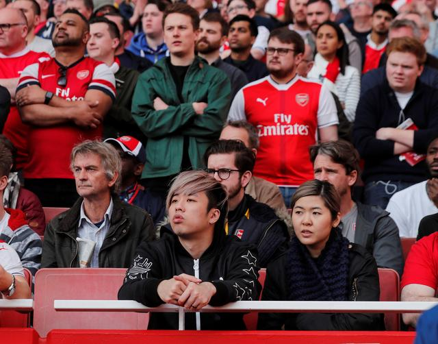 Leung Kit Ho from Hong Kong and his friend travelled 9,000km to to watch an match between Arsenal and Manchester City, in London, Britain April 2, 2017.  REUTERS/Eddie Keogh
