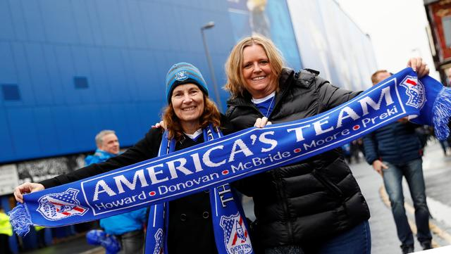 Mary Frisella (L) from San Diego in the U.S. and Carol Aleman from Fullerton in the U.S. pose for a photograph at a Premier League soccer match between Everton and Hull City, in Liverpool, Britain March 18 , 2017.  REUTERS/Jason Cairnduff