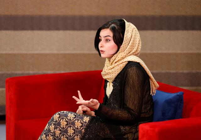 Shamela Rasooli, 22, Afghan presenter, records her morning TV programme at the Zan TV station (women's TV) in Kabul, Afghanistan May 8, 2017.  REUTERS/Mohammad Ismail
