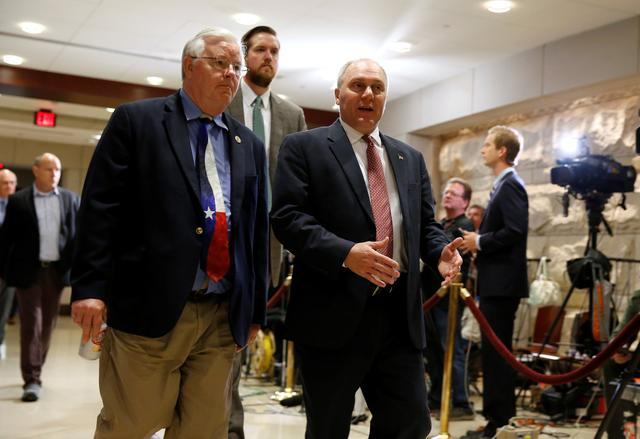 House Majority Whip Steve Scalise (R-LA) (R) and Republican Joe Barton (R-TX) arrive for a closed briefing for members of the House of Representatives by Deputy Attorney General Rod Rosenstein to discuss the firing of former FBI Director James Comey, on Capitol Hill in Washington, U.S., May 19, 2017. REUTERS/Joshua Roberts