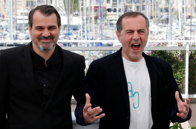 70th Cannes Film Festival - Photocall for the film ''Jupiter's Moon'' (Jupiter holdja) in competition - Cannes, France. 19/05/2017.  Director Kornel Mundruczo poses with cast member Merab Ninidze. REUTERS/Regis Duvignau