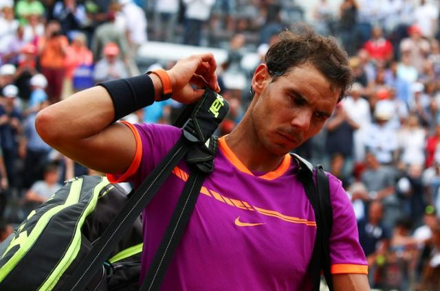 Tennis - ATP - Rome Open - Dominic Thiem of Austria v Rafael Nadal of Spain - Rome, Italy - 19/5/17 - Nadal leaves at the end of the match. REUTERS/Alessandro Bianchi