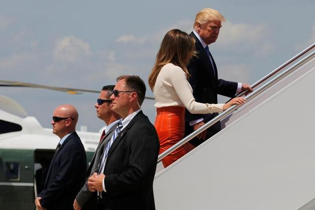 U.S. President Donald Trump and first lady Melania Trump board Air Force One for his first international trip as president, including stops in Saudi Arabia, Israel, the Vatican, Brussels and at the G7 summit in Sicily, from Joint Base Andrews, Maryland, U.S., May 19, 2017. REUTERS/Jonathan Ernst