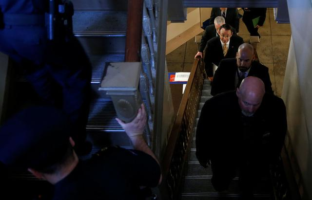 Deputy Attorney General Rod Rosenstein climbs stairs after a closed briefing for members of the House of Representatives to discuss the firing of former FBI Director James Comey on Capitol Hill in Washington, U.S., May 19, 2017. REUTERS/Joshua Roberts
