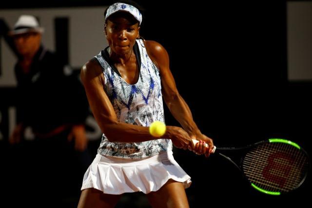 Tennis - ATP - Rome Open - Garbine Muguruza of Spain v Venus Williams of the United States - Rome, Italy - 19/5/17 - Williams of the United States returns the ball. REUTERS/Stefano Rellandini