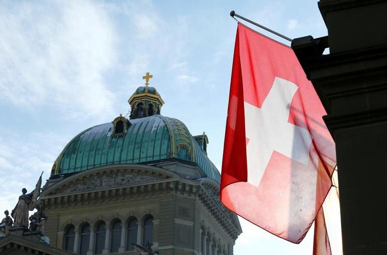 A Swiss flag is pictured in front of the Federal Palace (Bundeshaus) is pictured in Bern, Switzerland, January 16, 2017. REUTERS/Denis Balibouse