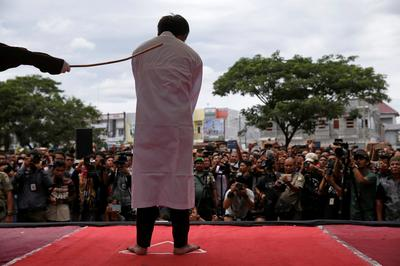 Two gay men publicly caned in Indonesia
