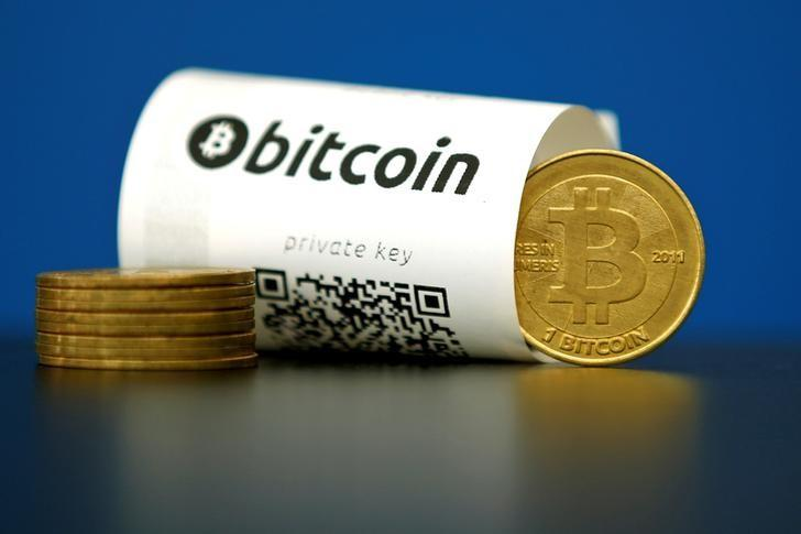 A Bitcoin (virtual currency) paper wallet with QR codes and a coin are seen in an illustration picture taken at La Maison du Bitcoin in Paris, France, May 27, 2015.  REUTERS/Benoit Tessier/File Photo