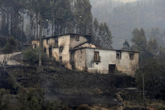 A burnt house is seen during a forest fire in Pedrogao Grande, in central Portugal, June 18, 2017.  REUTERS/Miguel Vidal