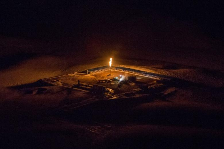 FILE PHOTO - An aerial image shows a natural gas flare after sunset outside of Williston, North Dakota March 12, 2013. REUTERS/Shannon Stapleton