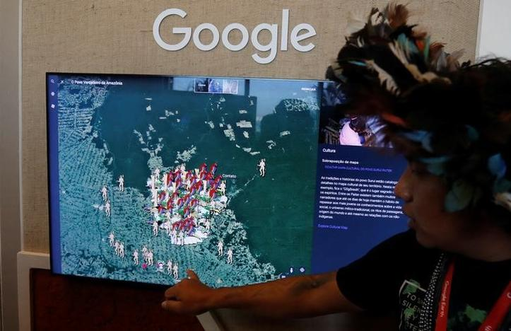 A Brazilian indigenous from the Surui-Paiter tribe introduces the 'I'm Amazon by Google' during the presentation of new Google Earth project in Sao Paulo, Brazil July 11, 2017. Leonardo Benassatto