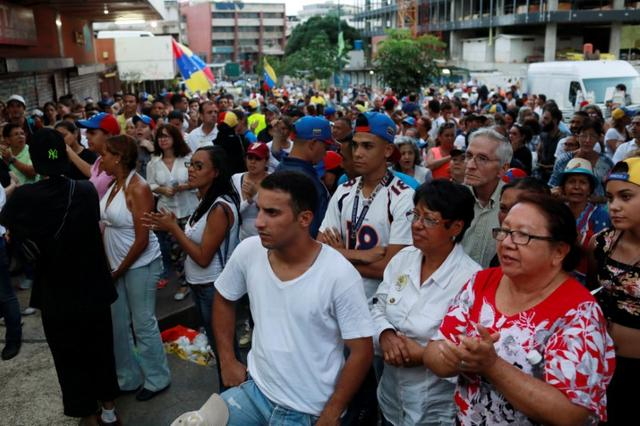 Opposition supporters wait near a polling station for results of an unofficial plebiscite against President Nicolas Maduro's government and his plan to rewrite the constitution, in Caracas, Venezuela July 16, 2017. REUTERS/Marco Bello