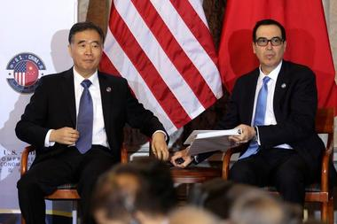 U.S. Treasury Secretary Steve Mnuchin and China's Vice Premier Wang Yang...