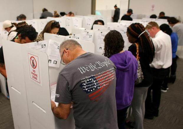 FILE PHOTO: A voter wears a shirt with words from the United States Constitution while casting his ballot early as long lines of voters vote at the San Diego County Elections Office in San Diego, California, U.S., November 7, 2016. Mike Blake