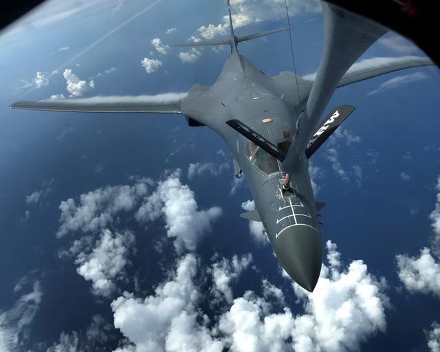 One of two U.S. Air Force B-1B Lancer bombers is refueled during a 10-hour mission flying to the vicinity of Kyushu, Japan, the East China Sea, and the Korean peninsula, over the Pacific Ocean. U.S. Air Force/Airman 1st Class Gerald Willis/Handout via REUTERS
