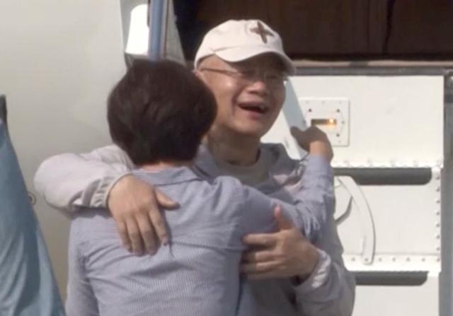 Rev. Hyeon Soo Lim, who was imprisoned in North Korea for more than two years, is seen reuniting with his wife Keum Young Lim (C) as he returned to Canada in this still image captured from a video in Toronto, Ontario, Canada, August 12, 2017.   Courtesy Light Presbyterian Church/Handout via REUTERS