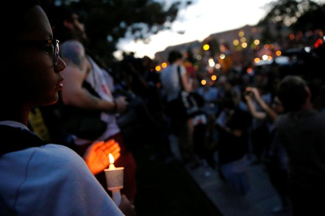 People gather for a vigil in response to the death of a counter-demonstrator at the ''Unite the Right'' rally in Charlottesville, in Washington, U.S. August 13, 2017.  REUTERS/Jonathan Ernst