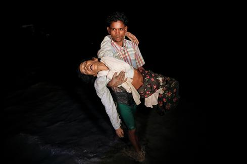 Rohingya flee under cover of darkness