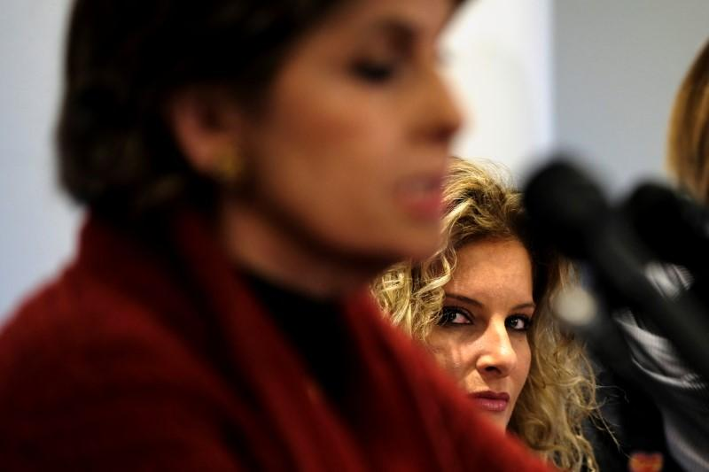 Summer Zervos (R) listens as her attorney Gloria Allred (L) speaks to reporters about her defamation lawsuit against U.S. President Donald Trump ahead of the Women's March on Washington in Washington January 21, 2017. James Lawler Duggan