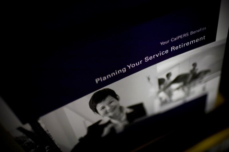 Retirement plan brochures are seen in a rack in Sacramento, California October 21, 2009. Max Whittaker