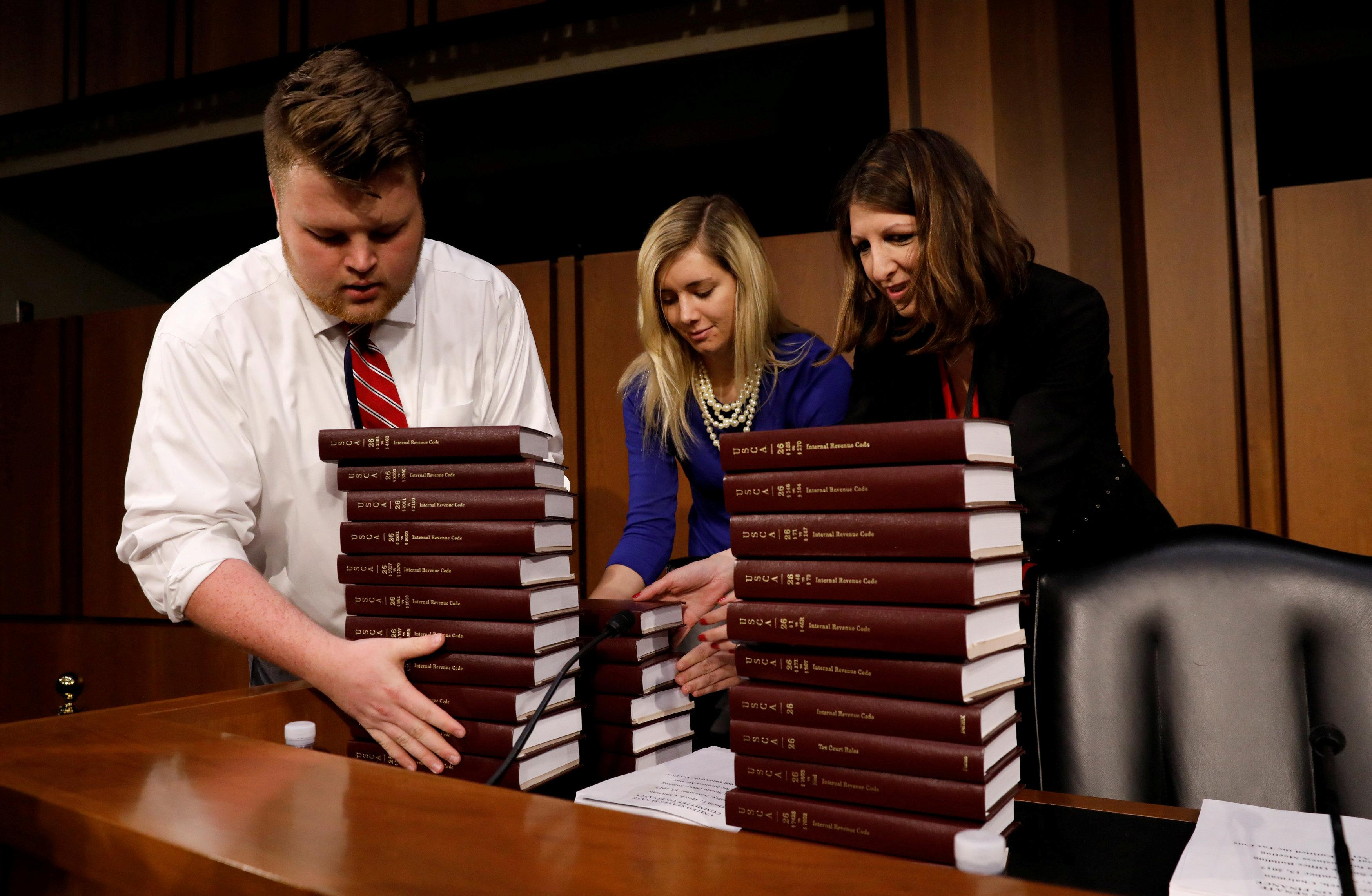 The Internal Revenue Code books are delivered to a Senate Finance Committee markup on the