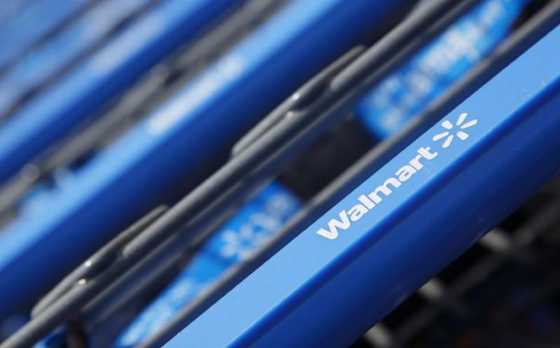 Shopping carts are seen outside a new Wal-Mart Express store in Chicago July 26, 2011. John Gress/Files