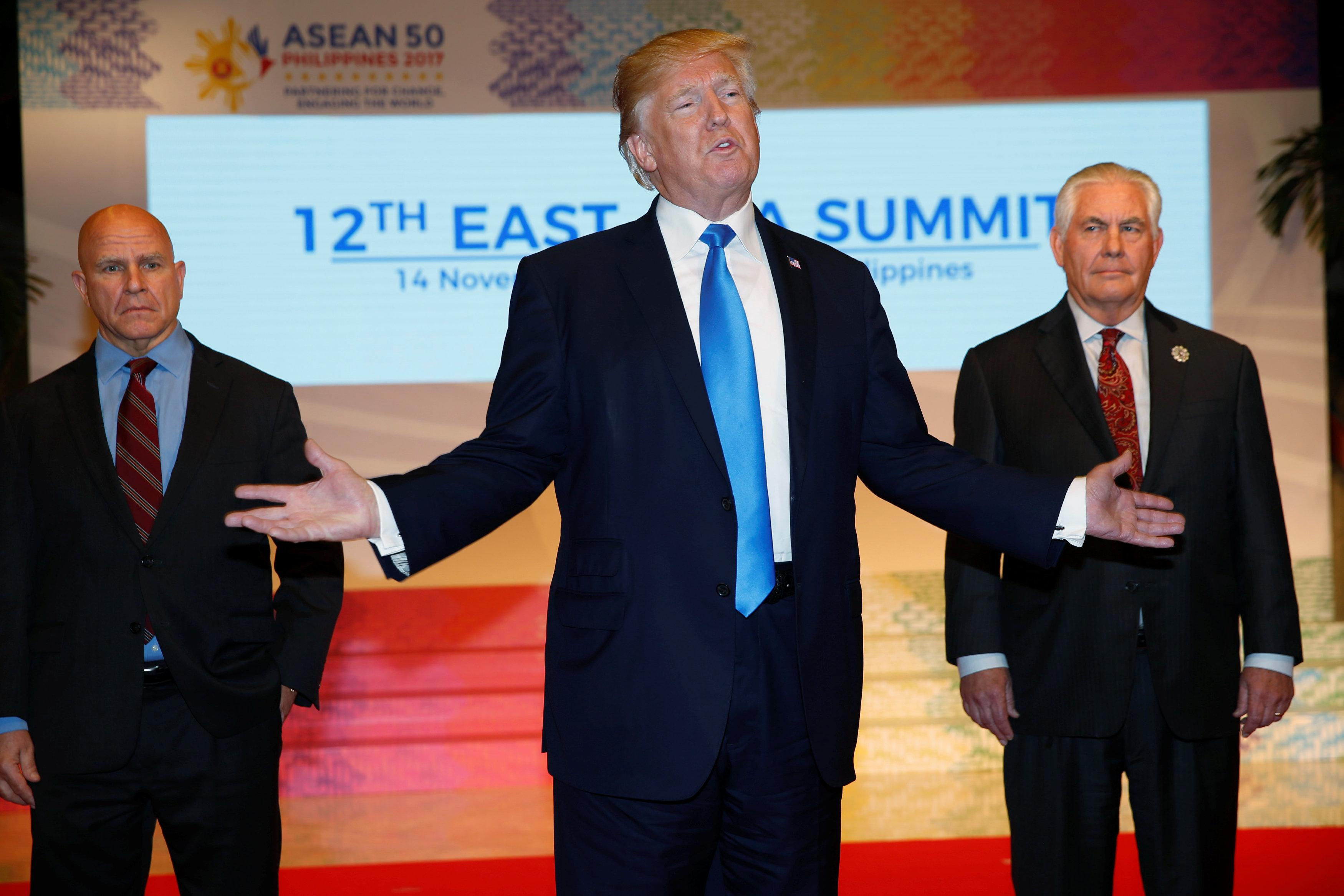 U.S. President Donald Trump makes remarks to the media as he attends the 12th East Asia Summit in Manila, Philippines November 14, 2017. Seen alongside are U.S. National Security Advisor H.R. McMaster (L) and U.S. Secretary of State Rex Tillerson (R). Jonathan Ernst