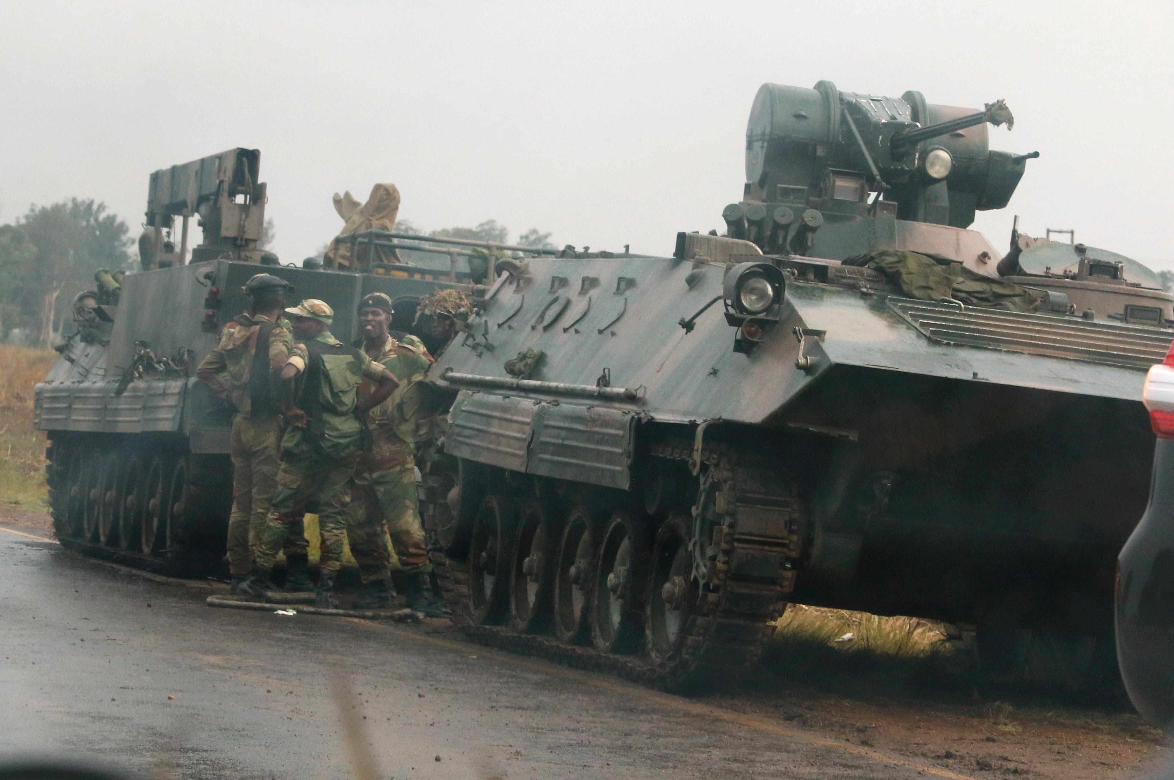 Soldiers stand beside military vehicles outside Harare, Zimbabwe, November 14,2017. Philimon Bulawayo