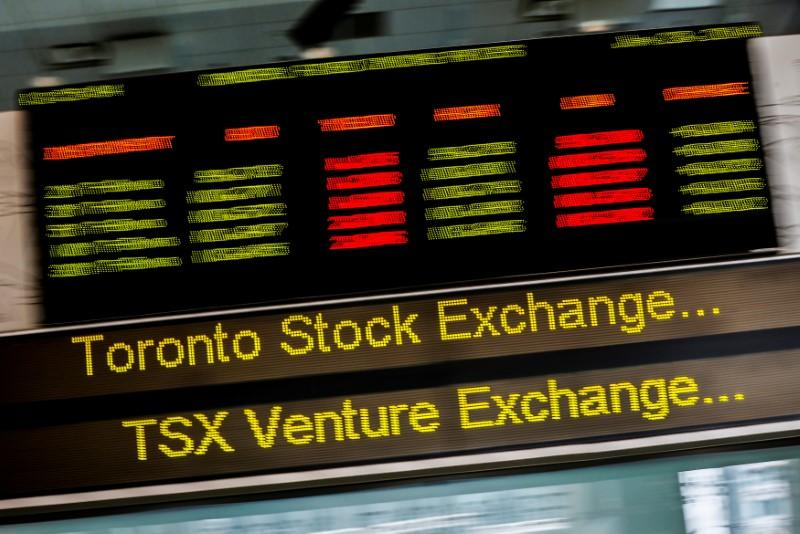 A sign board displaying Toronto Stock Exchange (TSX) stock information is seen in Toronto June 23, 2014.   Mark Blinch