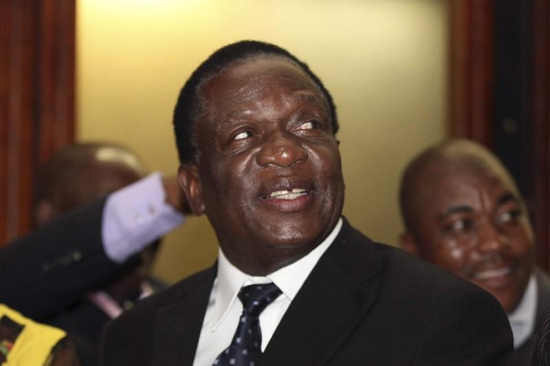 File Picture: Newly appointed Zimbabwean Deputy President Emmerson Mnangagwa smiles at the headquarters of President Robert Mugabe's ZANU (PF) in Harare, December 10, 2014.    Philimon Bulawayo