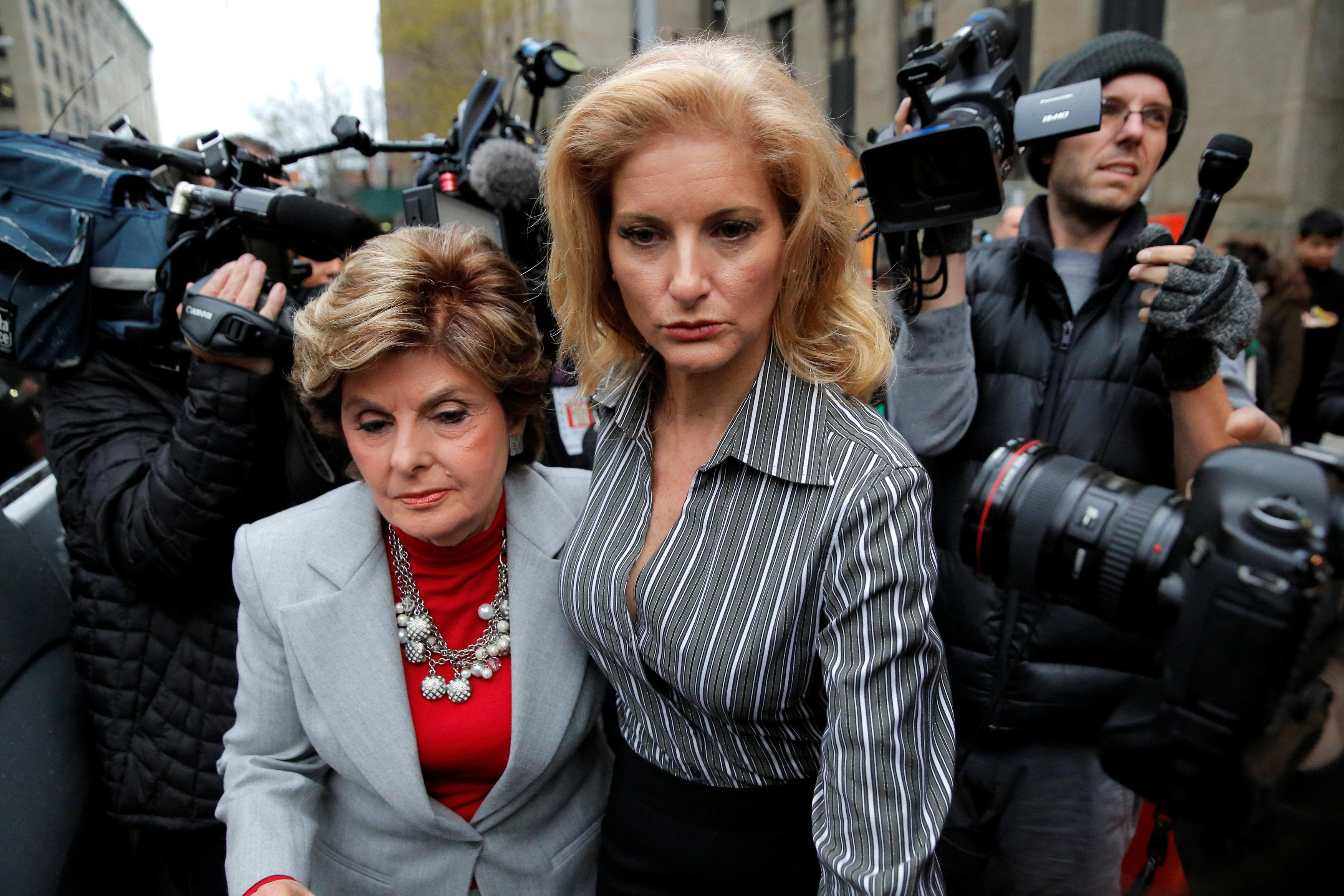 Summer Zervos, a former contestant on The Apprentice, leaves New York State Supreme Court with attorney Gloria Allred (L) after a hearing on the defamation case against U.S. President Donald Trump in Manhattan, New York City, U.S., December 5, 2017.  Andrew Kelly
