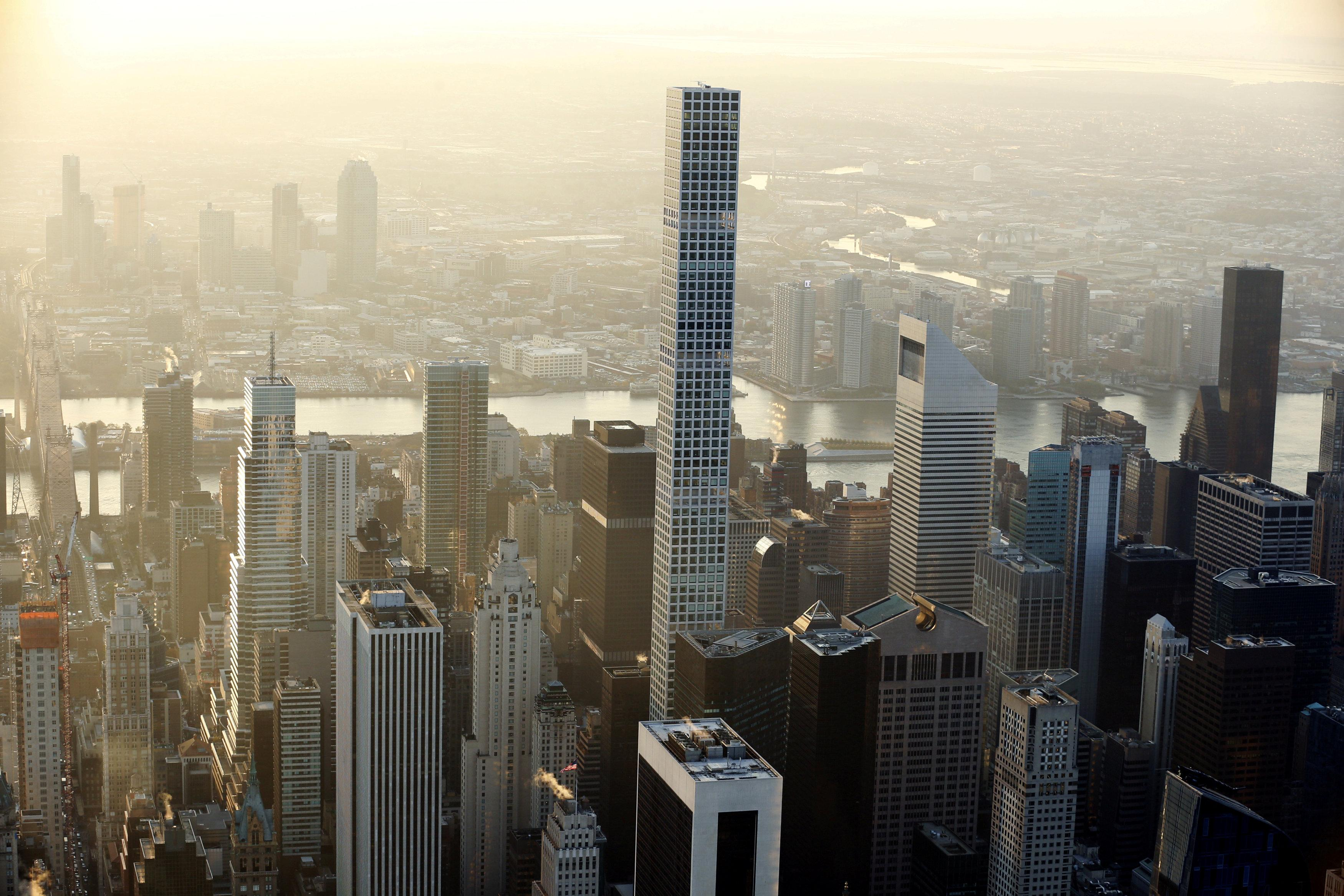 The building known as 432 Park Avenue rises above the Manhattan borough of New York, U.S. on November 2, 2016.    Lucas Jackson