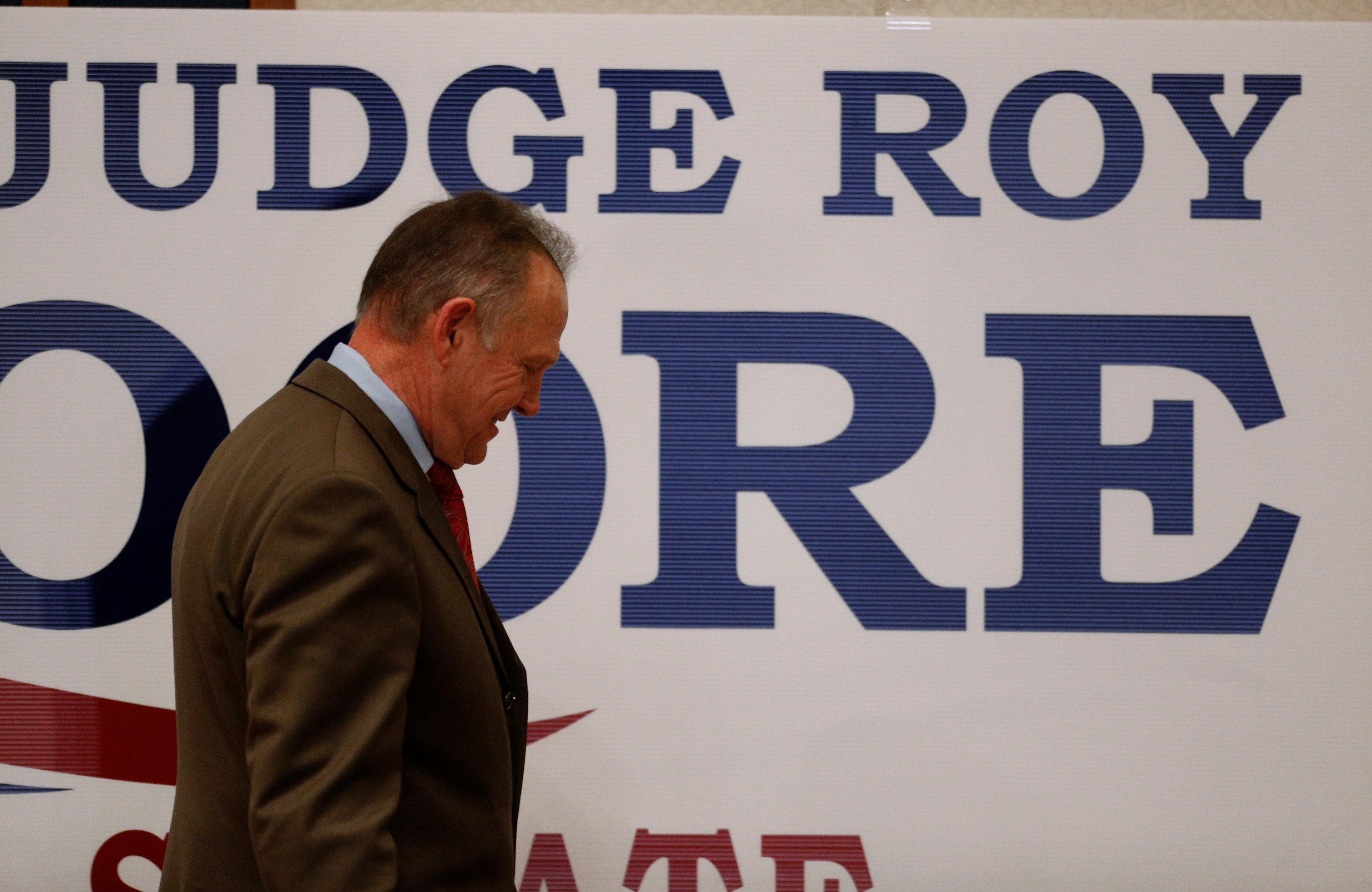 Republican Senate candidate Roy Moore leaves the stage after addressing supporters in Montgomery, Alabama, December 12, 2017. Jonathan Bachman
