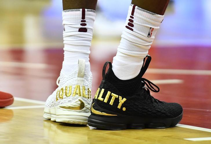 Dec 17, 2017; Washington, DC, USA; Cleveland Cavaliers forward LeBron James (23) wears Equality shoes against the Washington Wizards during the first half at Capital One Arena. Mandatory Credit: Brad Mills-USA TODAY Sports