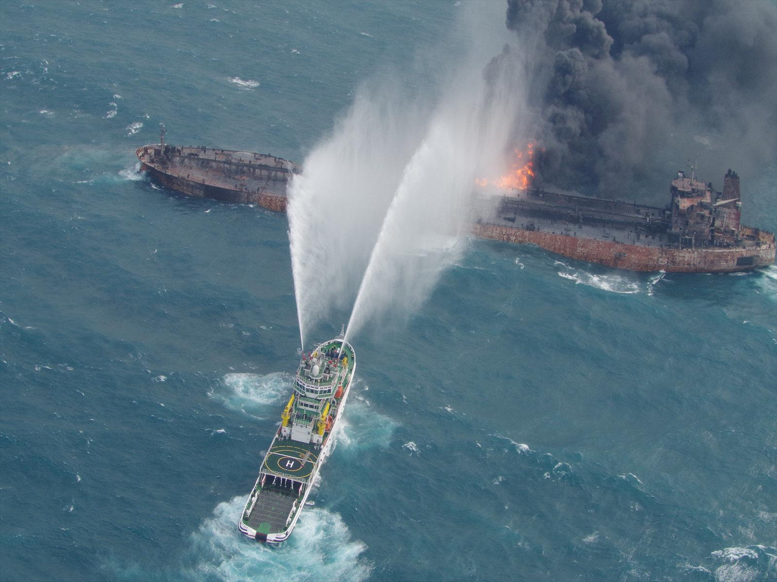 A rescue ship works to extinguish the fire on the stricken Iranian oil tanker Sanchi in the East China Sea, on January 10, 2018 in this photo provided by Japan's 10th Regional Coast Guard. Picture taken on January 10, 2018.  10th Regional Coast Guard Headquarters/Handout via