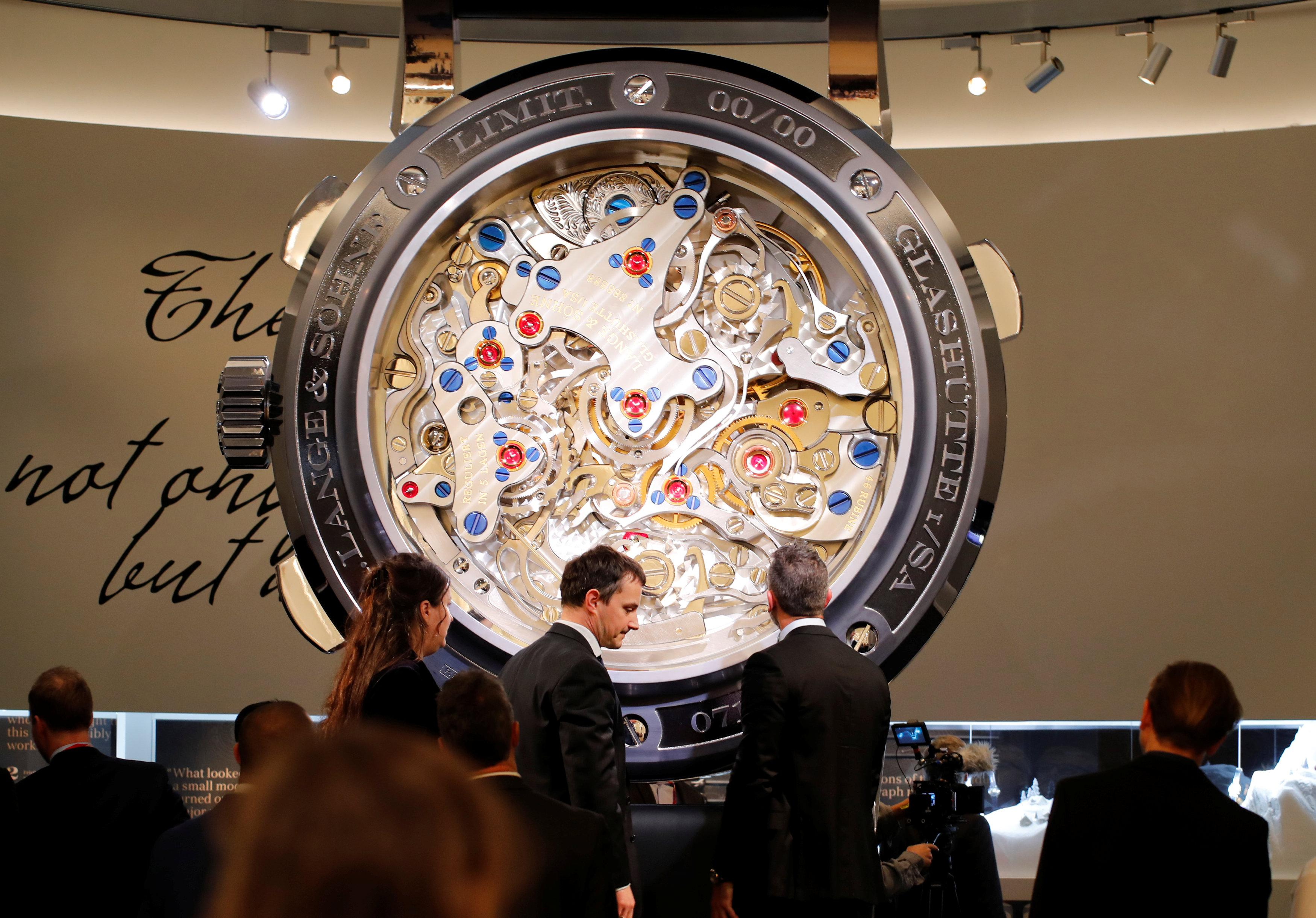 Visitors are pictured in the A. Lange & Soehne stand at the