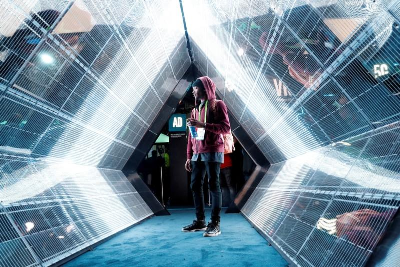 A visitor walks though Intel's 5G wireless broadband display at the 2018 Consumer Electronics Show in Las Vegas, January 9, 2018. Steve Marcus