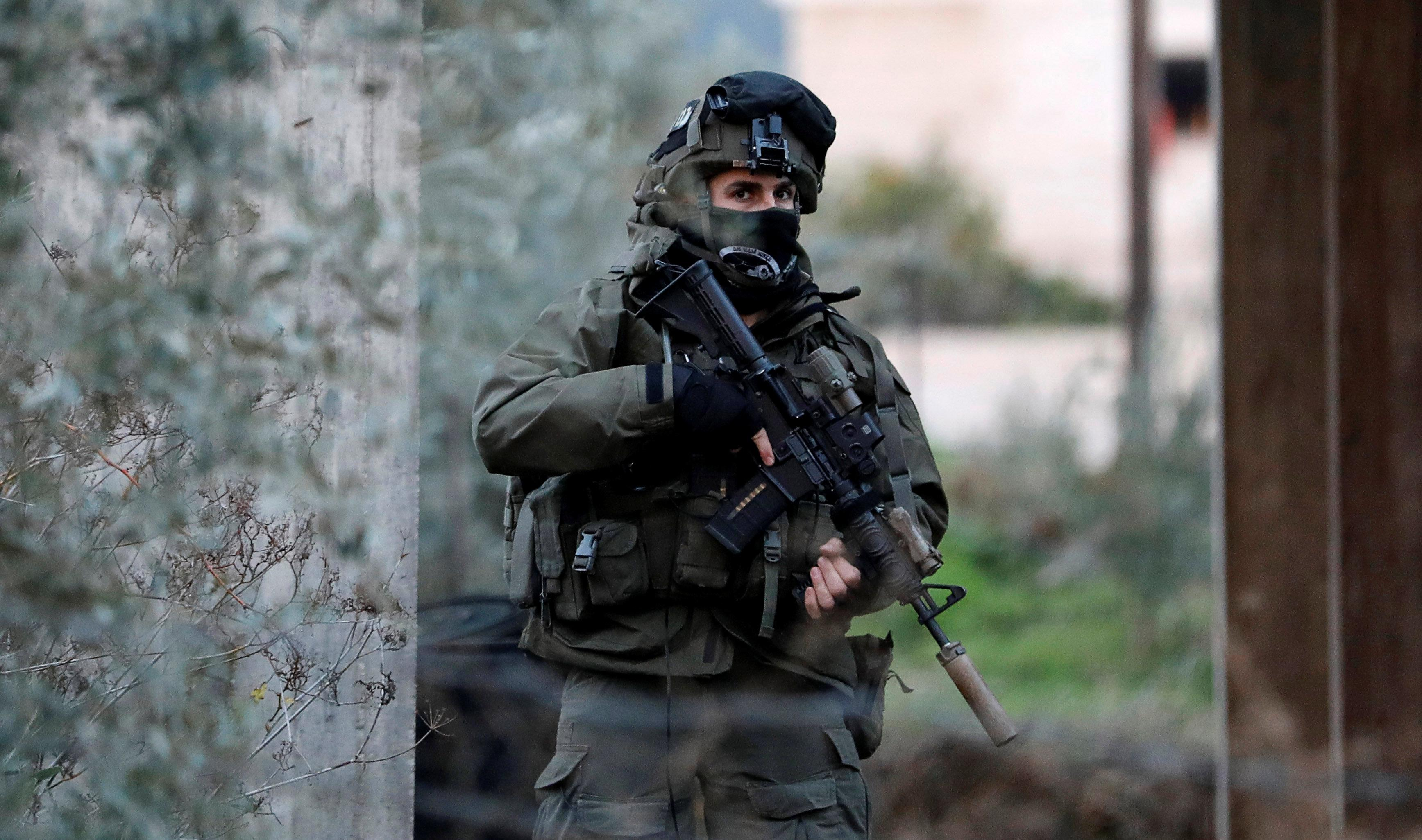A member of Israeli armed forces is seen during a raid in the West Bank city of Jenin, January 18, 2018. Mohamad Torokman