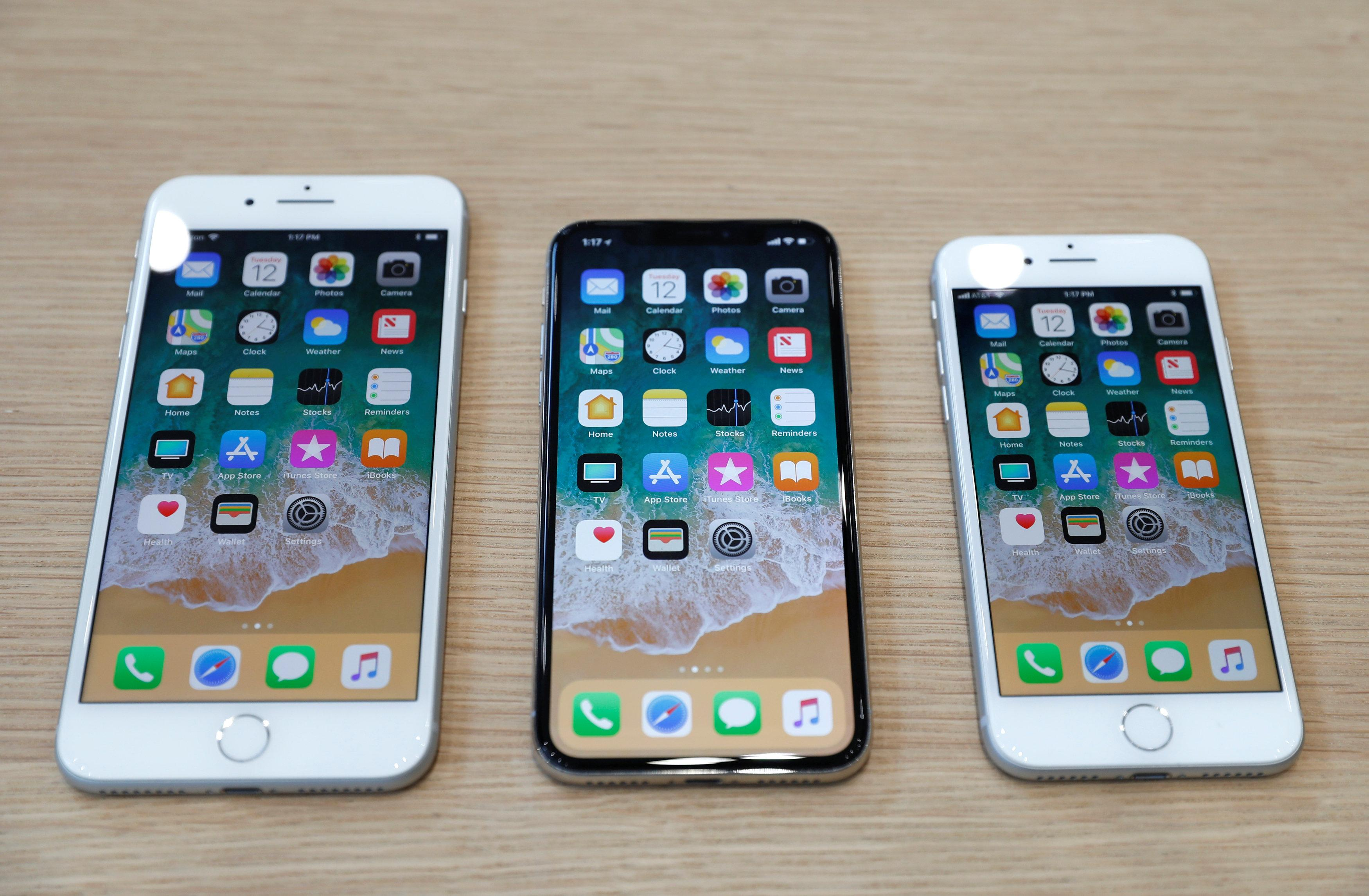 (L-R) iPhone 8 Plus, iPhone X and iPhone 8 models are displayed during an Apple launch event in Cupertino, California, U.S., September 12, 2017. Stephen Lam