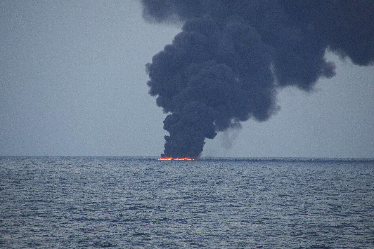 Flames and smoke from the Iranian oil tanker Sanchi is seen in the East China Sea, on January 15, 2018 in this photo provided by Japan's 10th Regional Coast Guard. 10th Regional Coast Guard Headquarters/Handout via