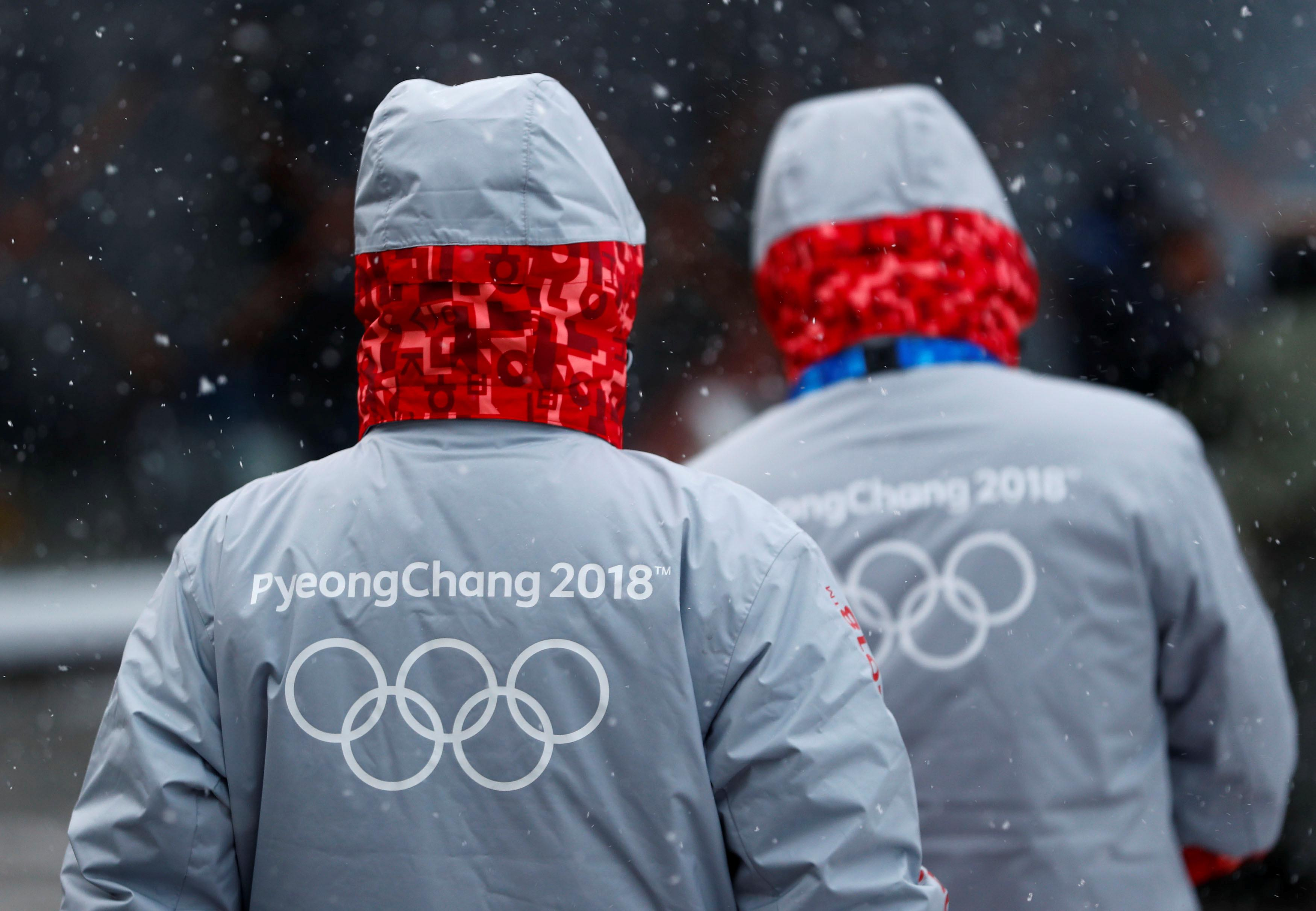 Volunteers for the upcoming 2018 Pyeongchang Winter Olympic Games walk in Pyeongchang, South Korea, January 22, 2018.   Fabrizio Bensch