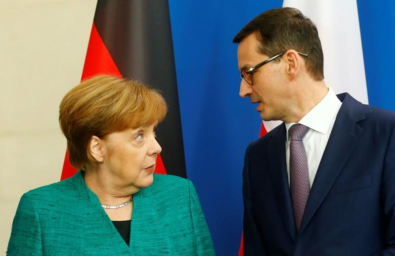 Chancellor Angela Merkel and Polish Prime Minister Mateusz Morawiecki address a news conference in Berlin, Germany, February 16, 2018. Hannibal Hanschke
