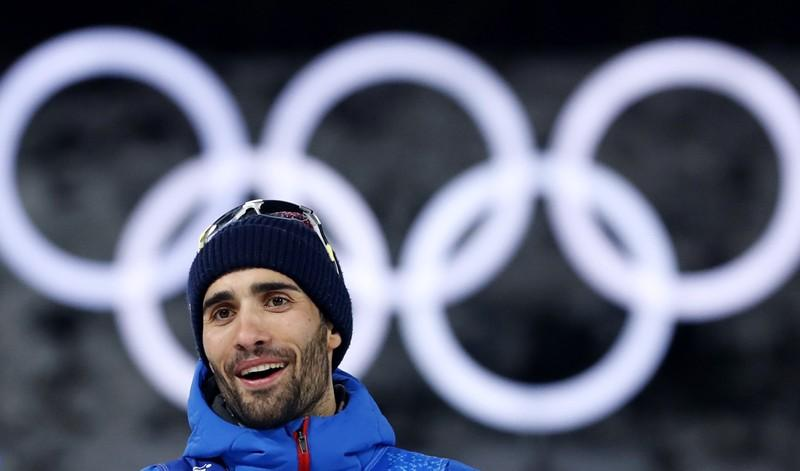 Biathlon - Pyeongchang 2018 Winter Olympics - Mixed Relay Final - Alpensia Biathlon Centre - Pyeongchang, South Korea - February 20, 2018 - Gold medalist Martin Fourcade of France reacts during the victory ceremony. Murad Sezer