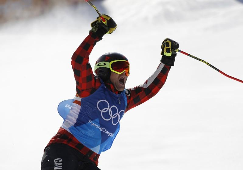 Freestyle Skiing - Pyeongchang 2018 Winter Olympics - Men's Ski Cross Finals - Phoenix Snow Park - Pyeongchang, South Korea - February 21, 2018 - Brady Leman of Canada reacts. Issei Kato