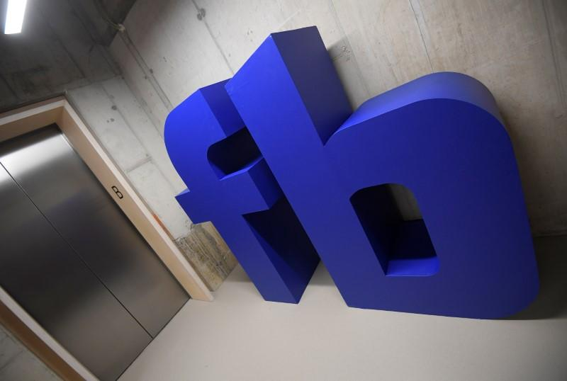 A giant logo is seen at Facebook's headquarters in London, Britain, December 4, 2017. Toby Melville