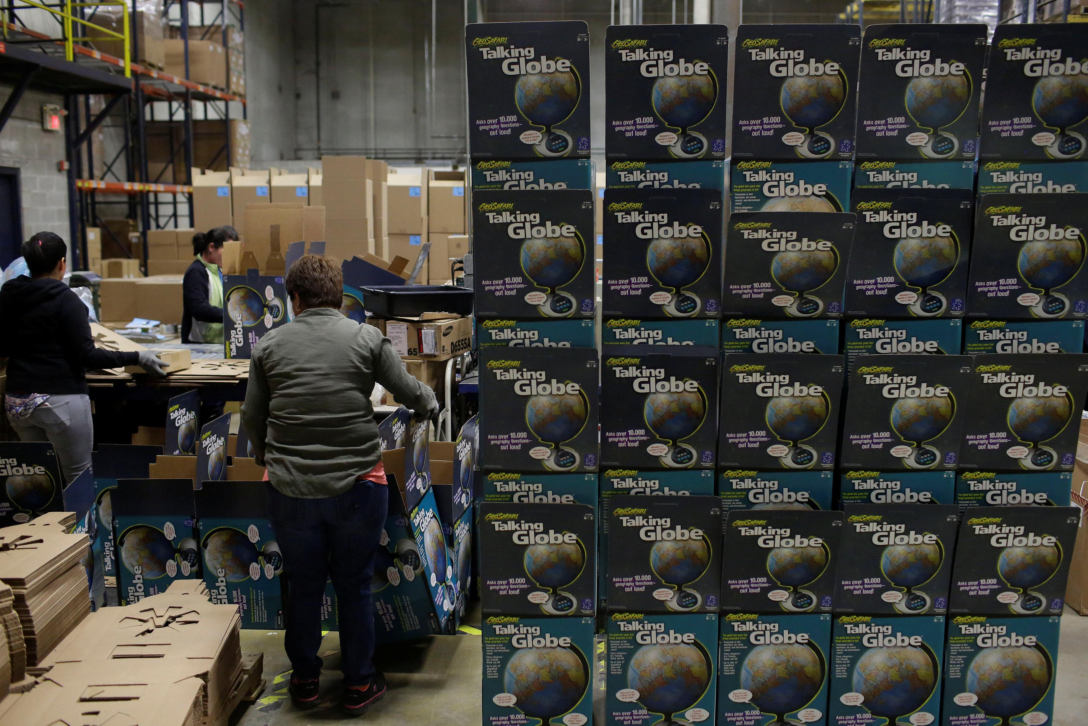 Exhausted toys r us suppliers weigh options as huge retailer toys r us vendor learning resources workers assemble boxes for globes at the warehouse buycottarizona Images